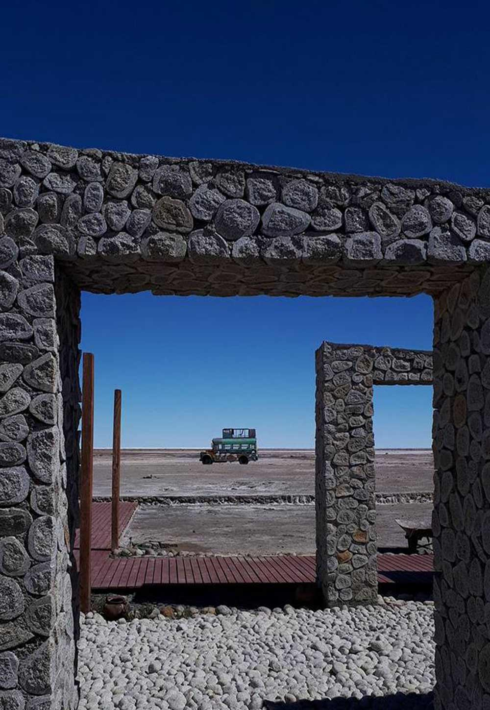 Bolivia bus through archway by Anthony Pulleine