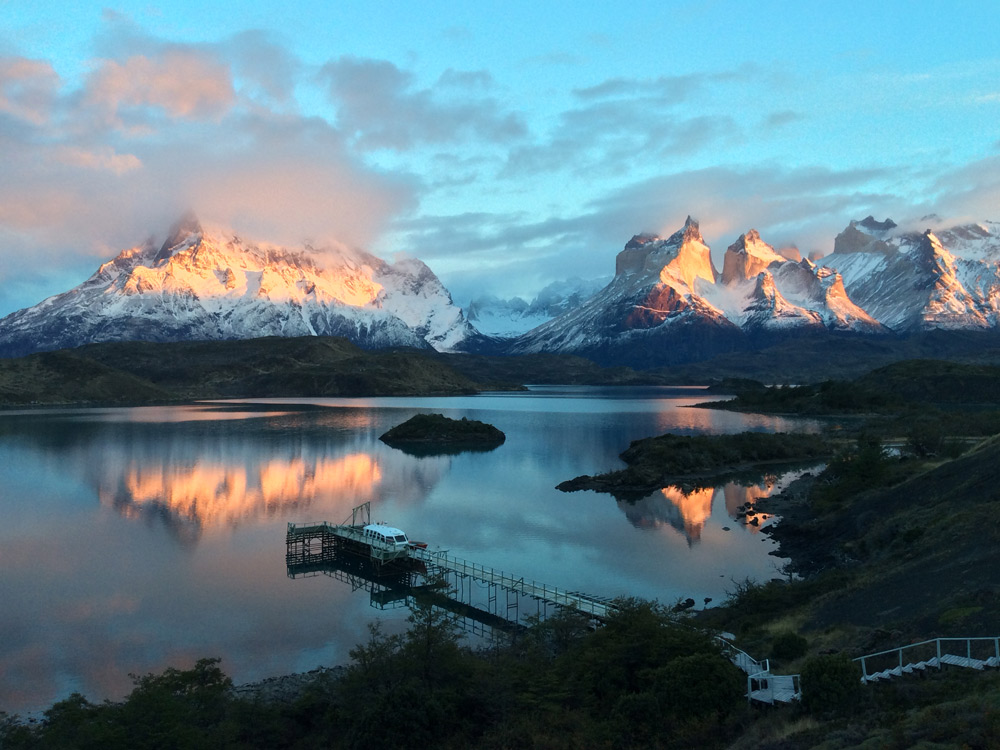 Sunrise from our room- Torres Del Paine, Chile by Peter Carlisle